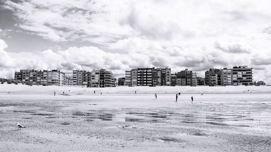 View from the oceanside Oceanside Beach Beachphotography Boulevard Apartments Oceanview Reflections Symmetry Blackandwhite Landscape Landscape_photography Clouds And Sky Grey Cloudy Day Beachlife Photography Beachscape Skyline Sand Sea People