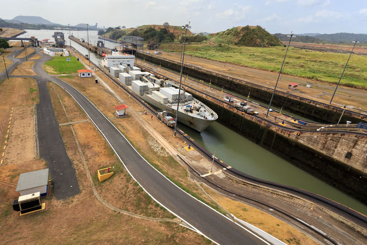 Canal De Panama  Cargo Ship Esclusas Miraflores Panama Canal Architecture Building Exterior Built Structure Day High Angle View Land Vehicle Mode Of Transport Nature No People Outdoors Road Sky Transportation Water