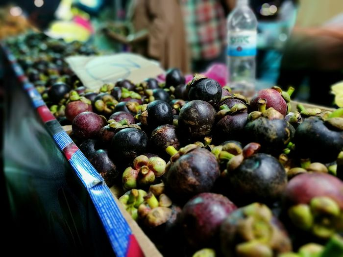 Close-up of mangosteen for sale at market stall