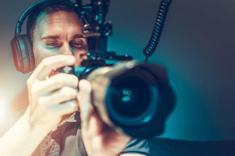 Close-up of man holding camera