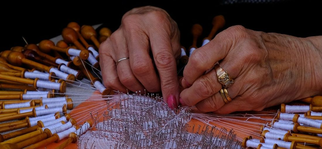 Cropped Hands Of Senior Woman Working With Thread And Needle