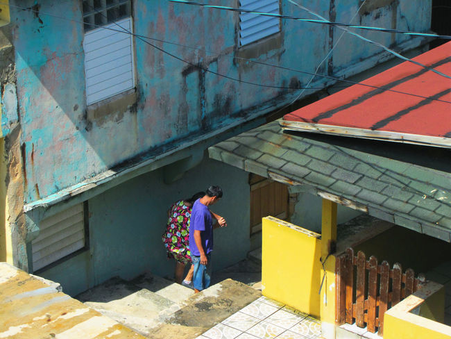 People going down the stairs in a ghetto of San Juan Puerto Rico Architecture Building Exterior Built Structure Corrugated Iron Day Full Length Ghetto Ghettolife Ghettoscenes Lifestyles One Person Outdoors People Real People Standing Walking Young Adult