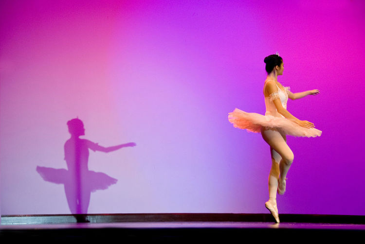 Side View Of Female Ballet Dancer Performing On Stage