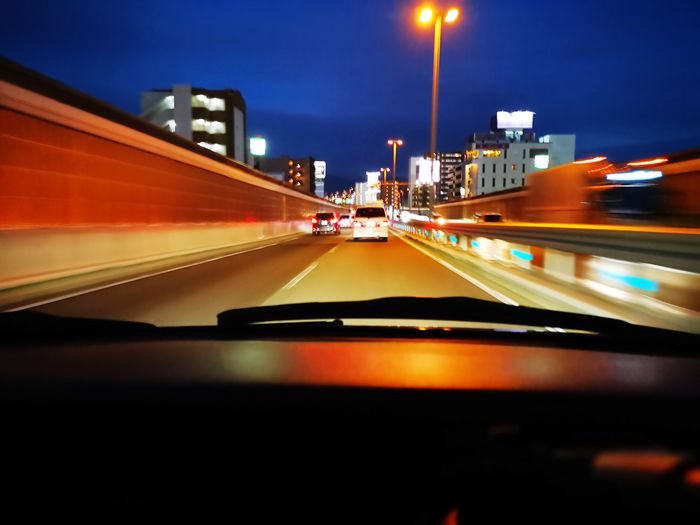 Blurred motion of car on road at night