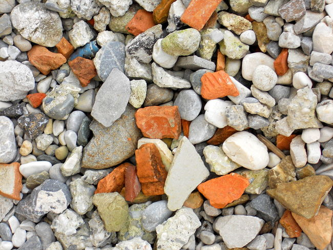 Full Frame Shot of pebbles and cobblestones background Abundance ArchiTexture Backgrounds Cobblestone Day Fragment Full Frame Gravel Grey No People Orange Outdoors Pebble Rock Sand Scrap Sliver Splinter Stone Stone - Object Textured  Textures And Surfaces