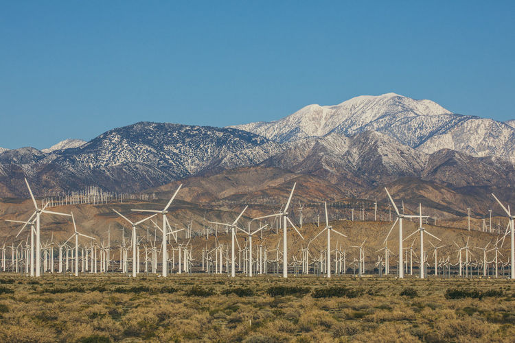 Alternative Energy Beauty In Nature Blue Clear Sky Day Environmental Conservation Fuel And Power Generation Grass Industrial Windmill Mountain Mountain Range Nature No People Outdoors Renewable Energy Sky Sustainable Resources Wind Power Wind Turbine Windmill