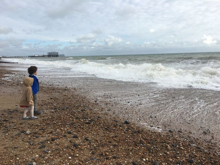 Children Beach Beauty In Nature Cloud - Sky Day Horizon Over Water Nature Outdoors Real People Scenics Sea Sky Standing Stony Beach Togetherness Tranquility Water Wave