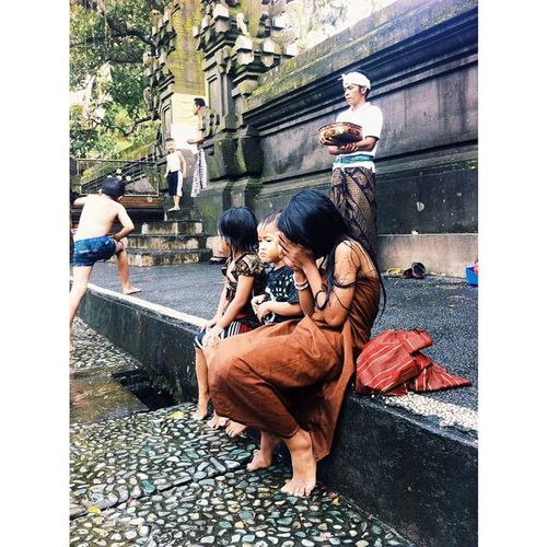 Hiding for the camera Kids Freezing Coldwater Longline Ceremony Tirtaempul  Temple Bali Shy