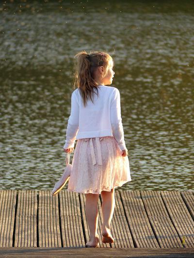 Innocence Child Sunlight Wondering Water Discovering Girl A New Beginning Leisure Activity Dress Long Hair Pier Lake