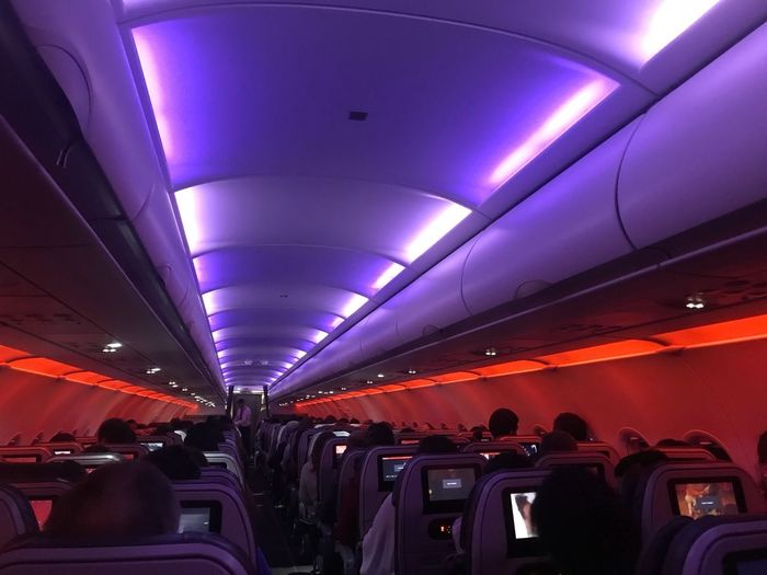 Travel, my passion Plane By Night Colofur Cabin Real People Transportation Travel Lifestyles Illuminated Large Group Of People Indoors  Journey Men Leisure Activity Sitting Women People