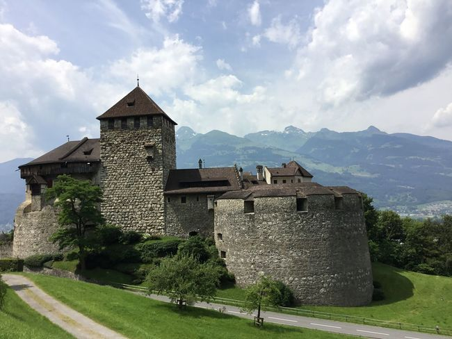 A road to a castle Architecture Built Structure Building Exterior Sky Building Mountain Cloud - Sky