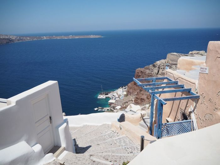 What a view Santorini, Greece EyeEm Selects Sea Water Beach Horizon Over Water Scenics - Nature Architecture Land Horizon Chair Beauty In Nature Sky Day Building Exterior Tranquil Scene No People High Angle View Sunlight Outdoors Built Structure Nature