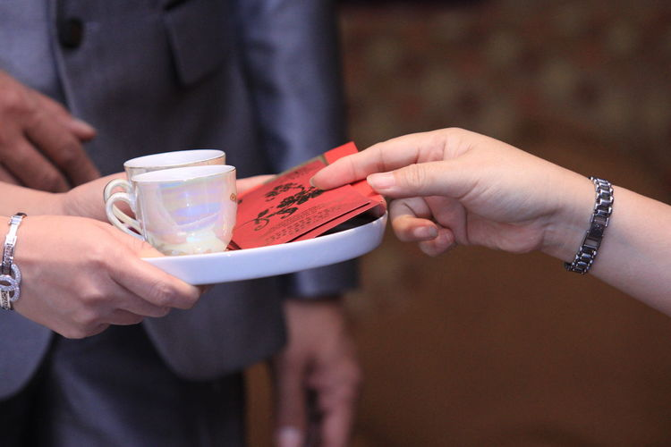 Chinese wedding tea Tea Human Hand Hand Holding Human Body Part Midsection Real People Focus On Foreground People Food And Drink Cup Close-up Finger Drink Chinese Chinese Wedding Tea Ceremony Chinese Wedding Photos Wedding Team