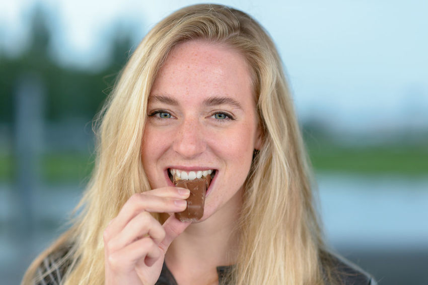 Chocolate Eating Woman Biting Candy Young Adult
