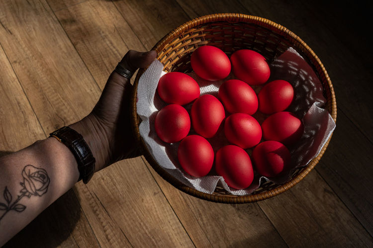 High angle view of tomatoes in basket on table