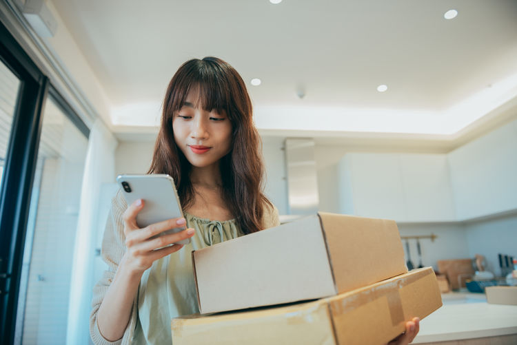 Portrait of woman using mobile phone
