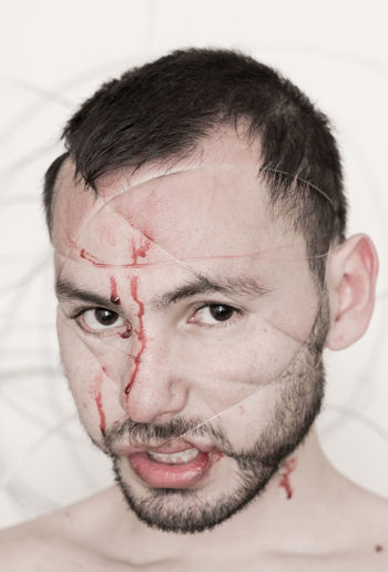 Close-up portrait of man wrapped with cable