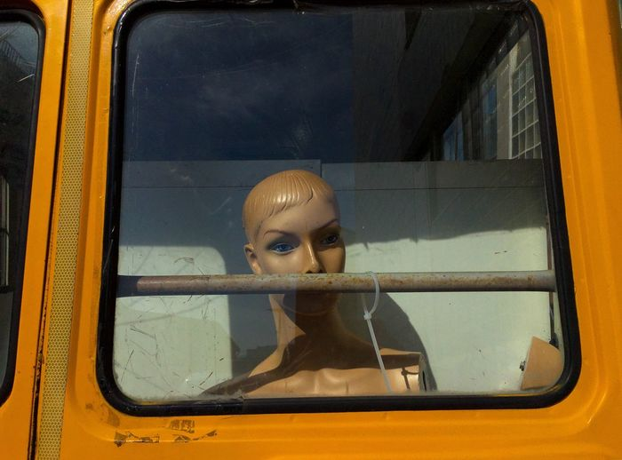 Mannequin seen through vehicle window