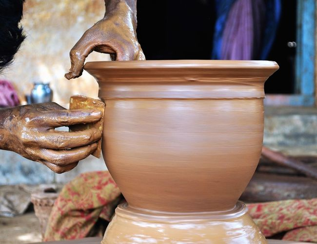 Cropped Image Of Craftperson Making Pottery