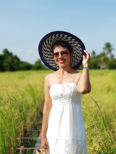 Woman in nature Tourism Travel Summer Sunlight Paddy Field Rice Paddy Nature Outdoors Hat Sunglasses Casual Clothing Smiling EyeEm Selects Young Women Portrait Women Beautiful Woman Rural Scene Standing Happiness Cereal Plant Fashion Field Farmland Wheat Barley Agricultural Field Sun Hat Straw Hat Wearing EyeEmNewHere