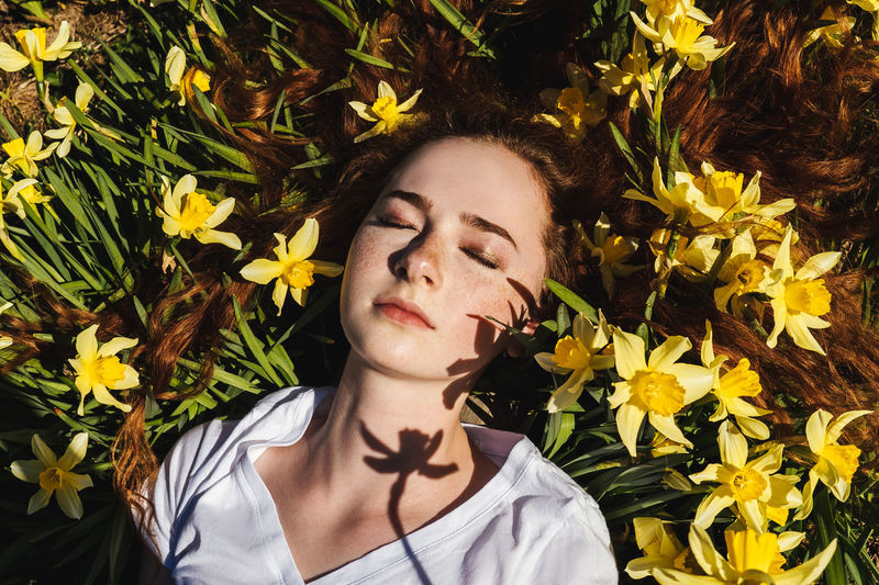 High angle view of girl by flowering plants