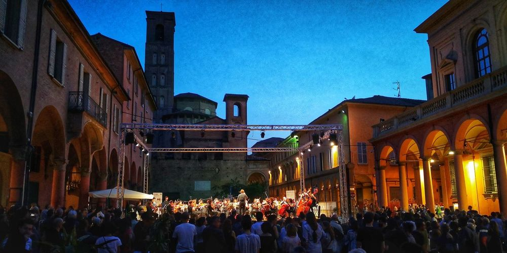 Live concert orchestra senzaspine City Center Cityscape Eyemphotography Bologna, Italy Bologna Historical Building Music Orchestra Orchestra Concert  Crowd Men Architecture Sky Building Exterior Built Structure Music Concert Festival Musical Instrument String Musical Equipment