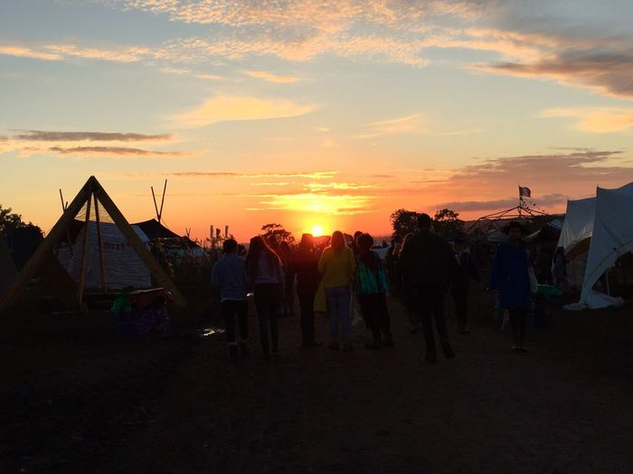 Glastonbury has the best sunsets 👌🌅 Festival Group Of People Sunset Clouds And Sky Golden Hour Walking Around Showcase July 43 Golden Moments People Together Tent Flag Perfect Moment Perfect Timing Festival Season Live For The Story