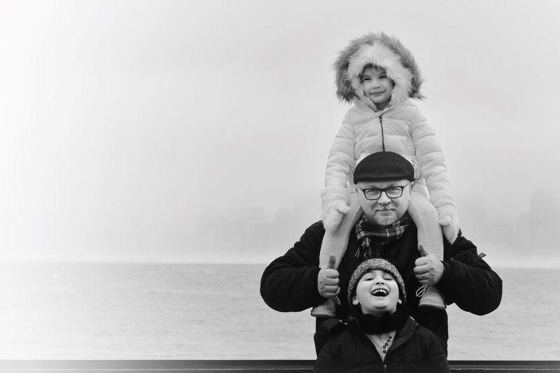 Father With Daughter And Son Against Sea And Sky