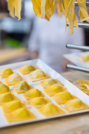 Making fresh ravioli and traditional pasta in a kitchen with cook in the background Cook  Cooking EyeEmNewHere Ravioli Close-up Day Food Food And Drink Freshness Indoors  Italian Food Italy❤️ Pasta Plate Ready-to-eat Yellow