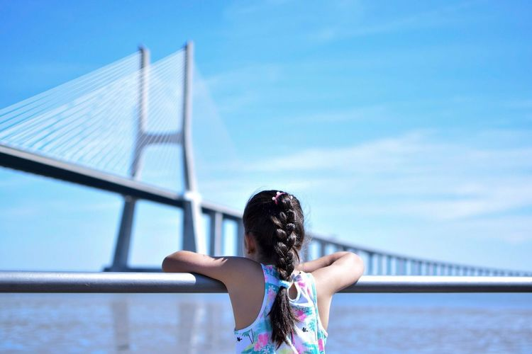 Dream big. Outdoors Architecture Day Real People One Person Sky Lifestyles River Bridge Urban First Eyeem Photo Simple Minimalist Minimalism Inspiration Blue Colorful Children Landscape Peaceful Focus On Foreground Tranquility Transportation Tranquil Scene