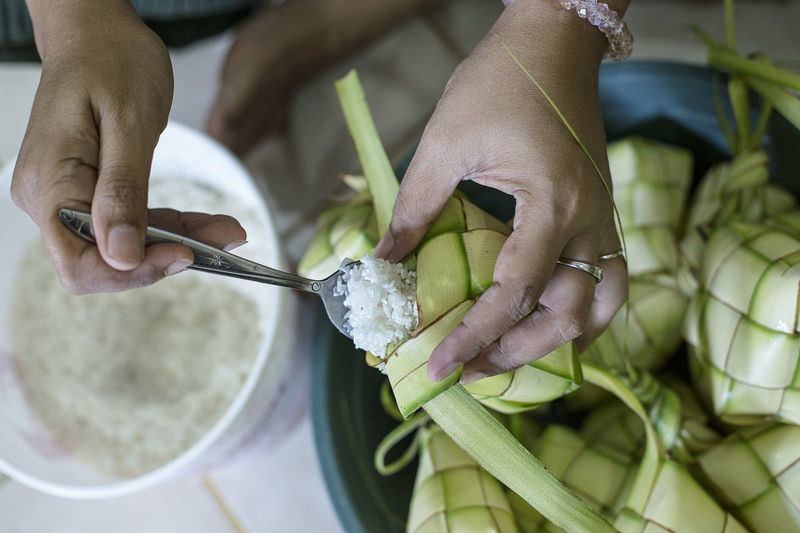 Making Ketupat, which is a typical food made from rice and served during eid al fitr and eid al adha INDONESIA Hands Moslem Islam Eid Eid Mubarak Eiduladha Eid Al Fitr Ied Ied Mubarak Ied Adha Iedqurban Indonesian Food Qurban Ketupat Ketupat Lebaran Rice Human Hand Close-up Finger