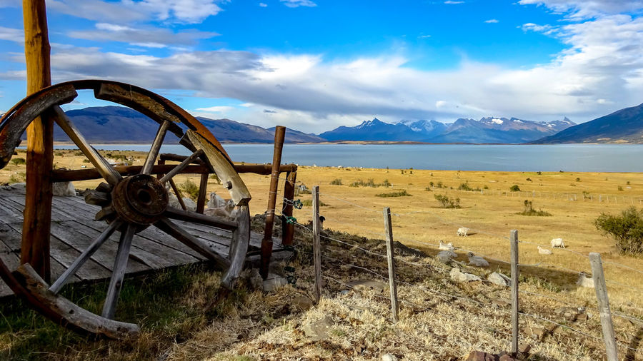 Argentina and the wheel Sky Cloud - Sky Mountain Land Nature Scenics - Nature Beauty In Nature Landscape No People Day Environment Field Barrier Fence Boundary Water Tranquility Wood - Material Metal Transportation Outdoors Wheel Wagon Wheel