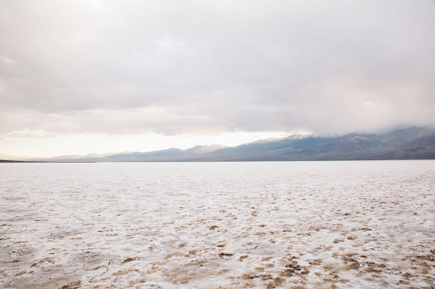 Arid Climate Arid Landscape Badwater Basin Beauty In Nature Day Death Valley Death Valley National Park Death Valley, California Desert Desert Landscape Landscape Mountain Nature No People Outdoors Salt Salt - Mineral Salt Flat Scenics Sky Tranquil Scene Tranquility Water