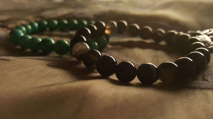 Pair of bracelets on fabric sheet
