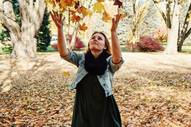 Portrait of young woman standing in autumn