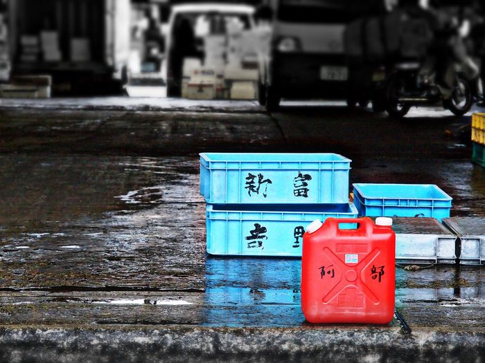 Crates on wet footpath