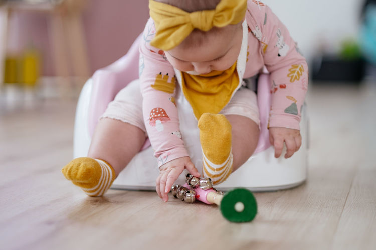 Midsection of girl playing on table