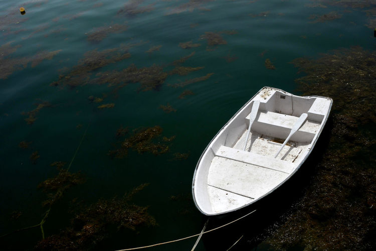 High angle view of abandoned boat moored in sea