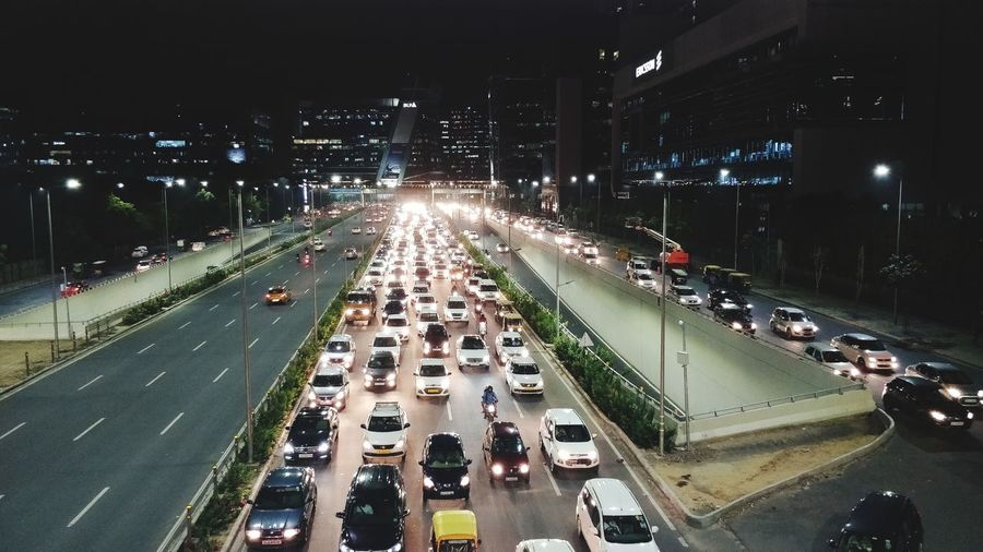 Traffic Moving Traffic Illuminated Water City Tree Land Vehicle Car High Angle View Road Architecture