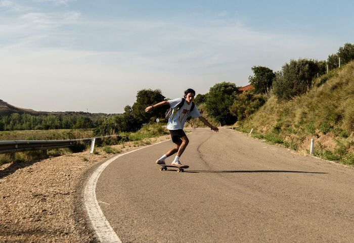 Young men doing skateboarding in a desertic road. Sport Sports Sportsman Sports Clothing Sports Photography Road Way Road Trip Colorful Skate Skateboarding Skateboard Skatelife Skater Skater Boy Road Desertic Men Athlete Sportsman Endurance Sports Clothing Sport Men Healthy Lifestyle Exercising Motion Running Shorts Shorts Athleticism EyeEmNewHere A New Beginning