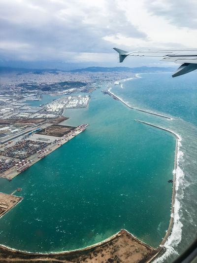 Aerial view of sea and airplane against sky