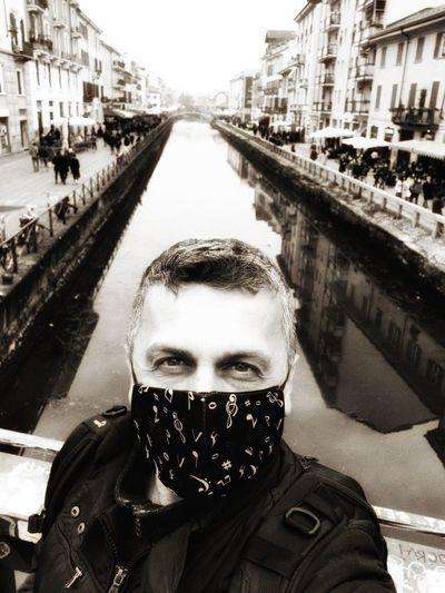 Portrait of man standing on bridge