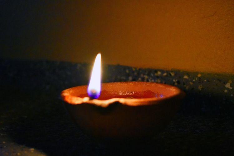 Burning Candle Close-up Diwali Diya - Oil Lamp Flame Glowing Heat - Temperature Illuminated Indoors  Night No People Rethink Things Be. Ready. Perspectives On Nature Eyemphotography Hindu Temple Hinduism Hindu Diwali Celebration