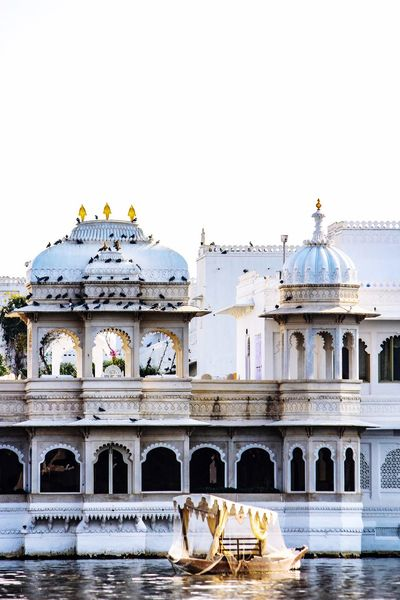 Architecture Built Structure Tourism Travel Destinations Travel Building Exterior Dome Outdoors Day Clear Sky City No People Sky Gondola - Traditional Boat White Birds Palace Udaipur India Travel Photography Lakepalaceudaipur The Week On EyeEm