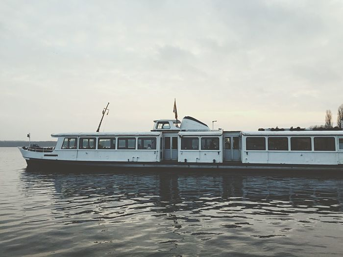 Ferry Boat In River Against Sky