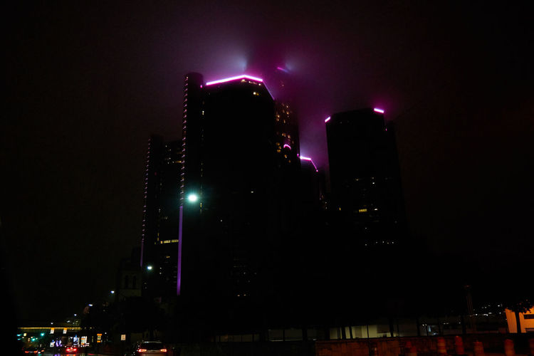 Architecture Built Structure City City Life Dark Detroit Eerie Fog Glowing GM Building Illuminated Light Low Angle View Modern Night No People Outdoors Rennaisance Center Skyscraper Tall - High
