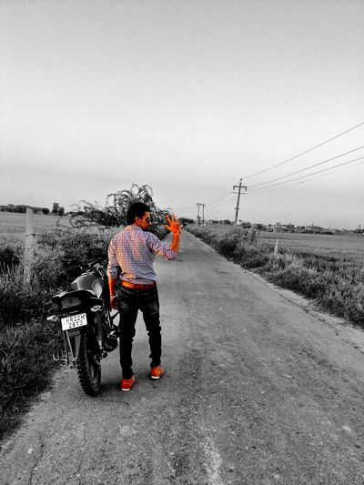 I captured this amazing photo when we were travelling on a straight road through fields. I got the view in my mind, we stopped and captured. Selfie Selfie ✌ Long Way Down Road On The Road Travelling With Friend Hanging Out Colorsplash