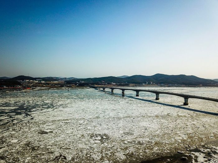Drift ice of Choji Bridge in Kanghwa island, Korea. Brıdge High Angle View Drone Photography WinterSea Ganghwa Island Korea Winter Sea Ice Sky Water Clear Sky Scenics - Nature Nature Tranquility Tranquil Scene Day Beauty In Nature Sea Outdoors Blue
