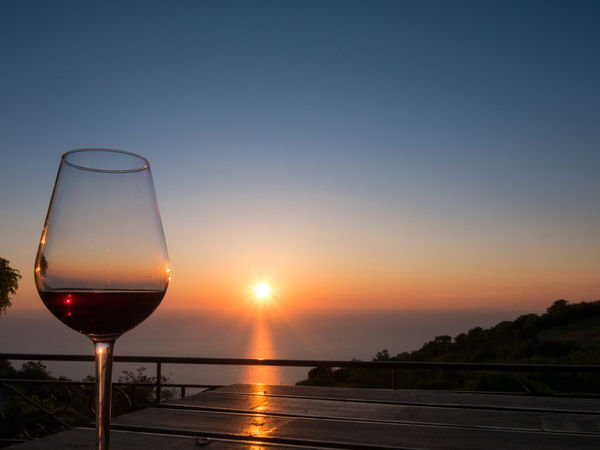 Enjoying a glass of wine. Beauty In Nature Clear Sky Close-up Day Drink Drinking Glass Food And Drink Horizon Over Water Nature No People Outdoors Red Wine Scenics Sky Sun Sunlight Sunset Travel Wine Wineglass Wine Not Summer Exploratorium
