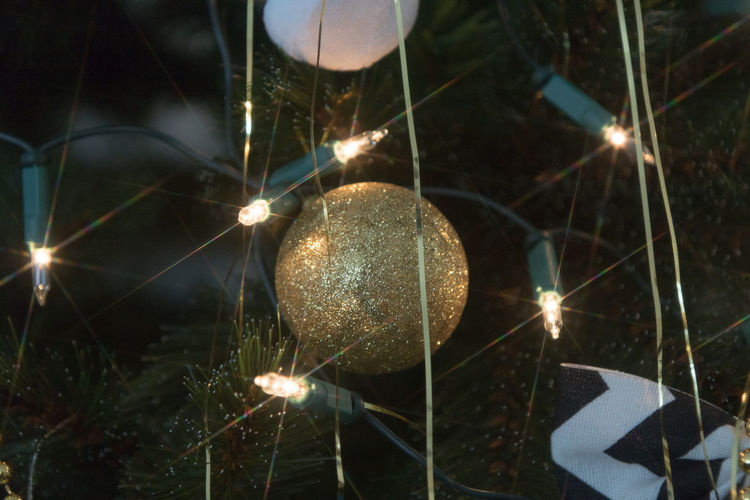 Illuminated Night Close-up Sphere No People Celebration Glowing Nature Focus On Foreground Decoration Lens Flare Light Lighting Equipment Plant Light Beam Outdoors Electric Light Transparent Reflection Sparks Christmas Christmas Decoration Christmas Ornament